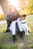 Cute Teenager girl with her Dog in beautiful park. — 图库照片