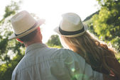 Young couple watching sunset — Stock Photo