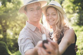 Lovely couple taking self portrait outdoor — Stock Photo