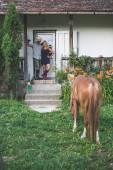 New house, happy  couple on doorstep — Stock Photo