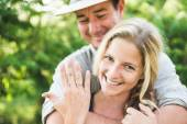Happy blonde woman showing engagement ring — Stock Photo
