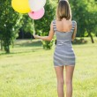Young beautiful girl with baloons posing outdoor — Stock Photo #76855301