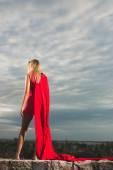 Young woman posing as superhero or wonderwoman — Stock Photo
