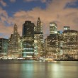 Skyscrapers in Manhattan at night, New York City. View from Brooklyn heights. — Stock Photo #82006844