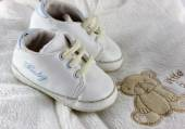 Baby stuff and shoes isolated on white — Stock Photo