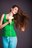 Woman with hair dryer — Stock Photo