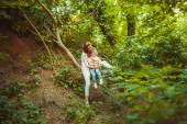 Mother with little daughter in forest — Foto Stock