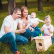 Happy family with nesting box and paints — Stock Photo #63885777