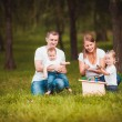 Happy family with nesting box and paints — Stock Photo #63884769