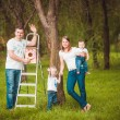 Happy family with Wooden birdhouse — Stock Photo #63885047