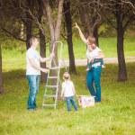 Happy family with Wooden birdhouse — Stock Photo #63885351