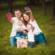 Happy family with nesting box and paints — Stock Photo #63885383