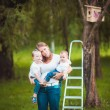 Happy family with Wooden birdhouse — Stock Photo #63885515