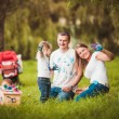 Happy family with nesting box and paints — Stock Photo #63885573