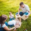 Happy family with nesting box and paints — Stock Photo #63885651