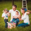 Happy family with nesting box and paints — Stock Photo #63885735
