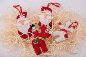 Christmas felt fabric deers and santa clauses — Stock Photo