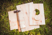 Birdhouse  parts with hammer — Stock Photo