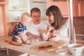 Happy family at kitchen — Stock Photo