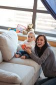 Mother and Baby boy on couch — Stock Photo