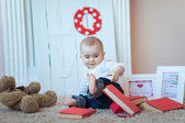 Funny baby with books — Stock Photo