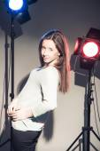 Woman posing in light flashes — Stock Photo