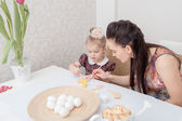 Mother and daughter  with Easter eggs — Stock Photo