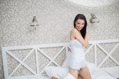 Pretty woman in white  bed — Stock Photo