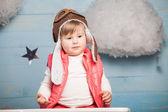 Little girl sitting in wooden toy plane — Foto de Stock