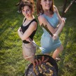 Two pretty girls making food on grill — Stock Photo #53124463
