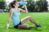 Tired woman runner taking a rest after run — Stock Photo