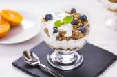 Delicious dessert, flakes flooded in two flavors yogurt with blu — Stock Photo