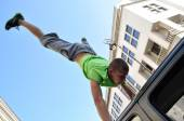 Handstand trick on the top of car — Stock Photo