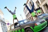 Handstand trick on the top of car. — Stock Photo