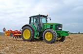 Tractor with a disc harrow system — Stock Photo