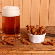 Mug with light beer and salty crackers — Stock Photo #57712283