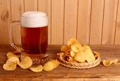 Glass of light beer and potato chips  — Stock Photo