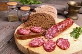 salami and bread on a cutting board — 图库照片