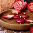 Spa concept with roses, pink salt and candles that float in wate — Stock Photo #62086489