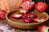 Spa concept with roses, pink salt and candles that float in wate — Stock Photo