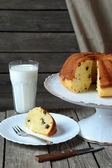 Homemade cake  with raisins and a glass of milk  — Stock Photo