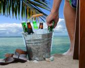 Man With Beer Bucket at the Beach — Stock Photo
