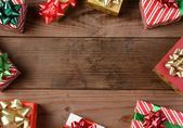 Rustic Wood Floor Christmas Presents — Stock Photo