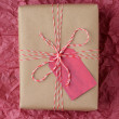 Christmas Gift on Red Tissue — Stock Photo #56288609