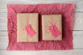 Two Gifts on Red Tissue Paper — Stock Photo