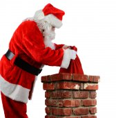 Santa Putting Bag into Chimney — Stock Photo