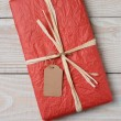 Red Present on White Wood — Stock Photo #58553445