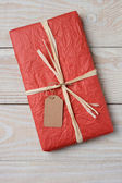 Red Present on White Wood — Stock Photo