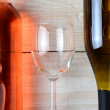 Wine Glass Between Two Bottles — Stock Photo #59333279