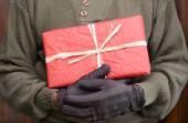Man Holding Christmas Present — Stock Photo